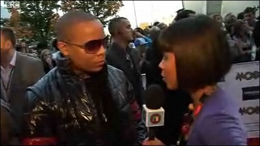 DJ Ironik talking to Leah on the red carpet at the Mobo awards in Glasgow