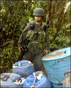 Anti-narcotics police with drums of chemicals used in drug production, Colombia, 1 October 2009