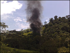Smoke rises after an illegal drugs laboratory is blown up by police, Colombia, 1 Oct 2009