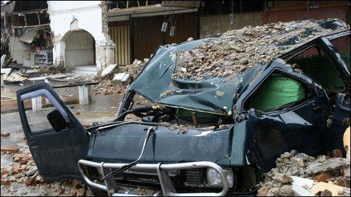 A van under rubble in Pariaman