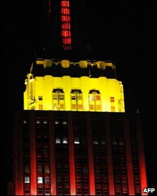 The Empire State Building lit red and yellow