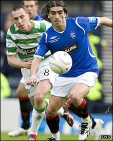 Pedro Mendes and Scott Brown in action