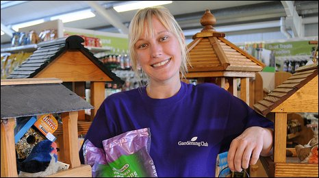 Customer Care Assistant, Emma Taggart gets ready to feed the birds