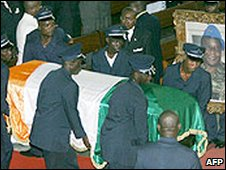 Soldiers carry Gen Guei's coffin