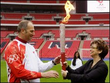 Redgrave receives the Olympic flame from Deputy Mayor of London, Nicky Gavron