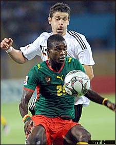 Germany's Semih Aydilek and Cameroon's Ghislain Mvom vie for the ball