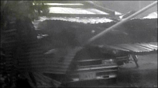 Car crushed by debris of typhoon Parma