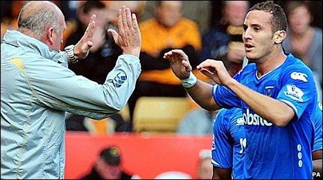 Portsmouth boss Paul Hart congratulates goalscorer Hassan Yebda