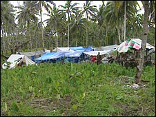 A collection of hastely erected make-shift tents on a Samoan hillside