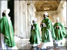 Cardinals and bishops arrive in procession at the St Peter's basilica on Sunday