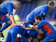 Inverness goalscorer Robert Eagle is engulfed by his team-mates after scoring the winner