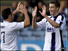 Ritchie Hart congratulates Dundee's third scorer Craig Forsyth (right)