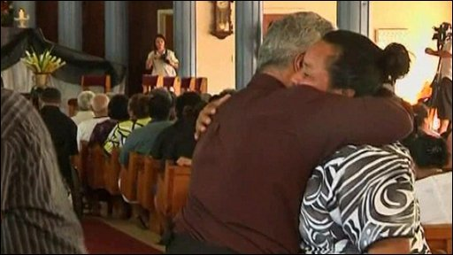 Samoans attend a church service to mourn tsunami dead