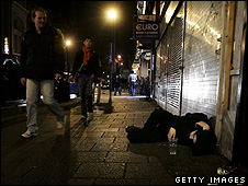 A drunk man passed out on a street