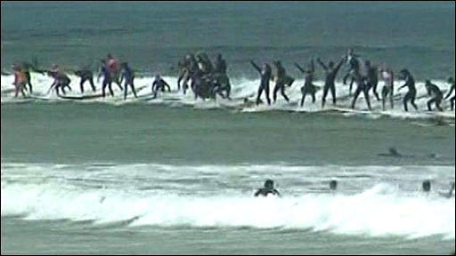 Surfers in Cape Town, South Africa, attempt the world record for surfing a wave
