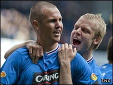 Kenny Miller (left) celebrates scoring against Celtic on Sunday