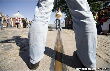 A visitor straddling the Greenwich Prime Meridian