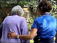 Care worker with an elderly resident