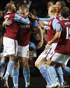 Richard Dunne (second from left) was calm after scoring against his former club