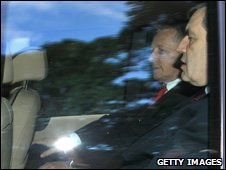 Peter Robinson (left) and Gordon Brown leaving Stormont on Monday