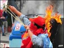 A protester uses a slingshot against Turkish riot police in Istanbul, Turkey, 6 October, 2009