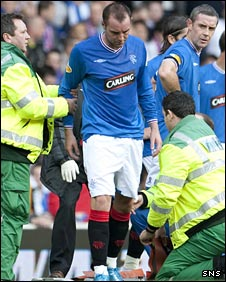 Kris Boyd prepares to leave the field after being injured against Celtic
