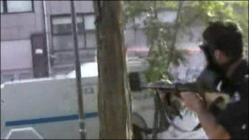 Man firing gun