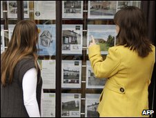 Looking in estate agents' window