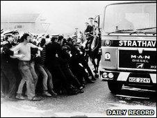 Police hold back protestors at Ravenscraig. Photo courtesy of The Daily Record