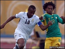 Ghana's Dede Ayew (left) battles for the ball with South Africa's Kermit Erasmus