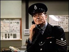 Actor Jack Warner as PC George Dixon