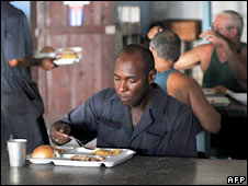 A worker eats in the factory canteen during lunch time in Havana. Photo: 5 October 2009