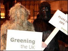 protesters dressed as a human shrub and a gorilla
