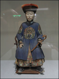 A small doll on the dislpay at the exhibition