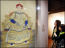 Visitors look at a portrait of Emperor Yongzheng