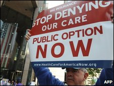 A member of the Health Access protest group holds a placard as part of their campaign against what they say is the poor state of US Healthcare in Los Angeles