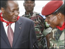 Burkina Faso President Blaise Compaore (L) is welcomed at Conraky airport by the Guinean leader Moussa Dadis Camara (R) on October 5, 2009