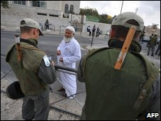 Israeli border police check the ID of a Palestinian man in occupied East Jerusalem