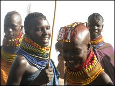 Turkana women joke as they wait