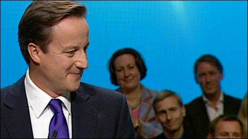 David Cameron smiling at wife Samantha