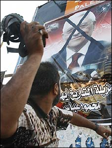 Gazan protester throws shoe at poster of Mahmoud Abbas