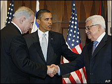 Handshake between Palestinian Authority Mahmoud Abbas and Israeli PM Benjamin Netanyahu durign tri-laterial meeting