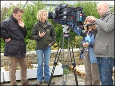 Chris Packham and Kate Humble prepare for a take