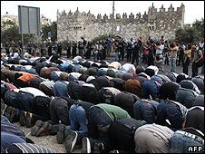 Palestinians pray outside the Old City in Jerusalem
