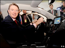 Peter Mandelson in an electric car