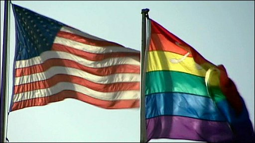 The Stars and Stripes flies next to the gay pride Rainbow flag