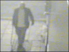 CCTV image of man with walking stick