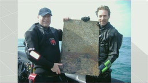 Divers uncover plaque