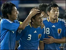 Yuichi Komano (centre) celebrates Japan's opening goal