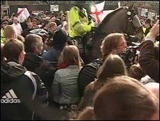 Police and protestors in Manchester city centre